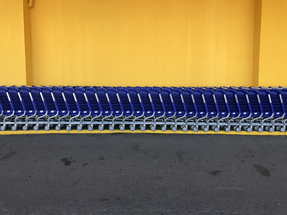 arranged blue grocery carts
