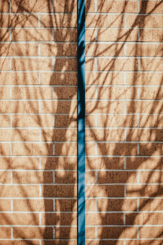 blue bar on brown concrete brick wall