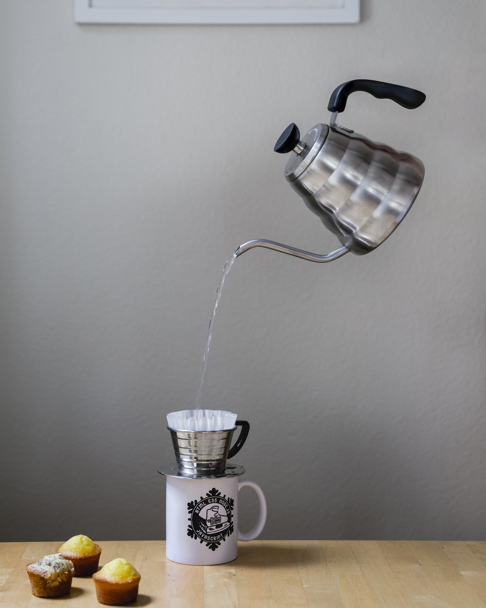 gray kettle pouring
