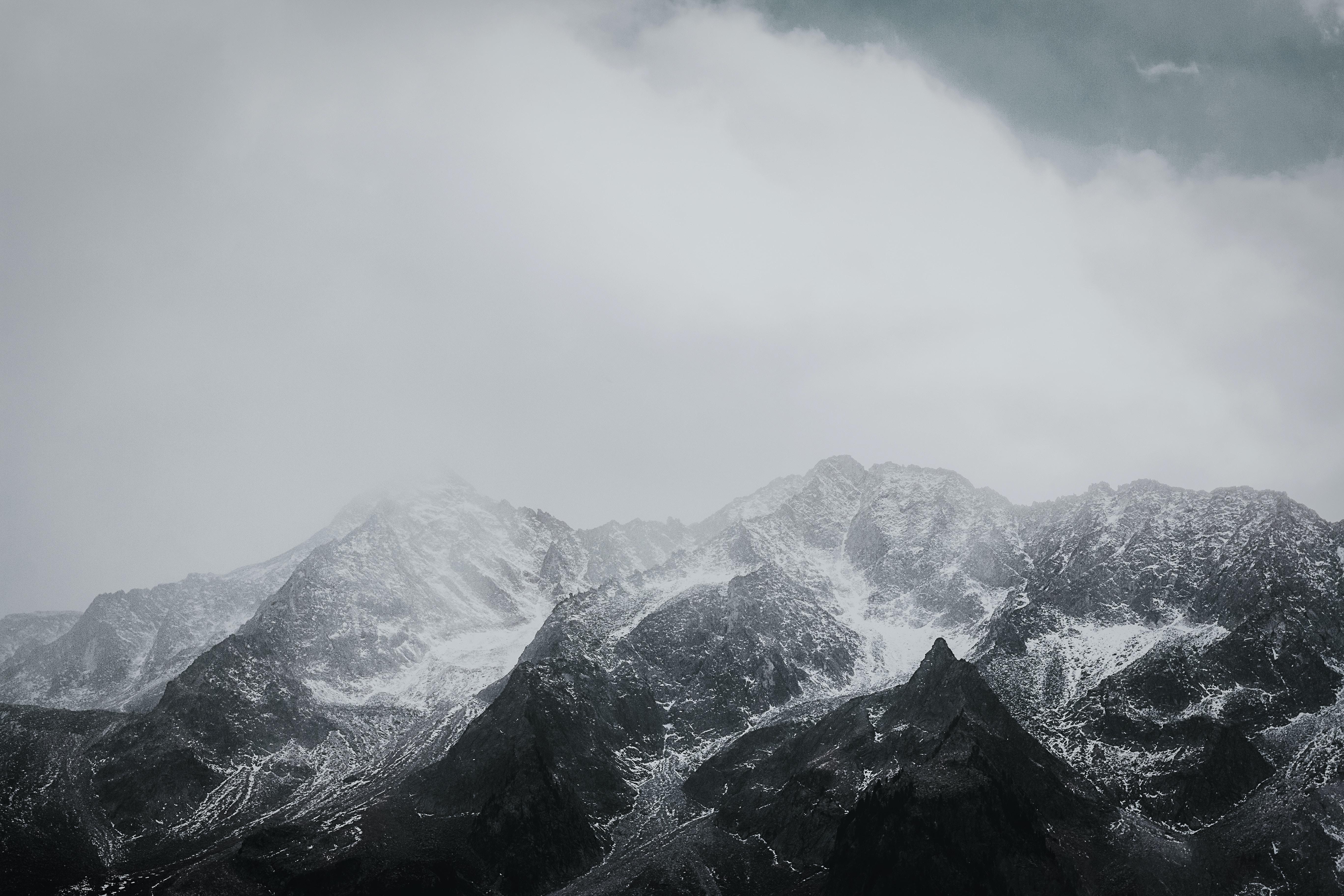 mountains under fog