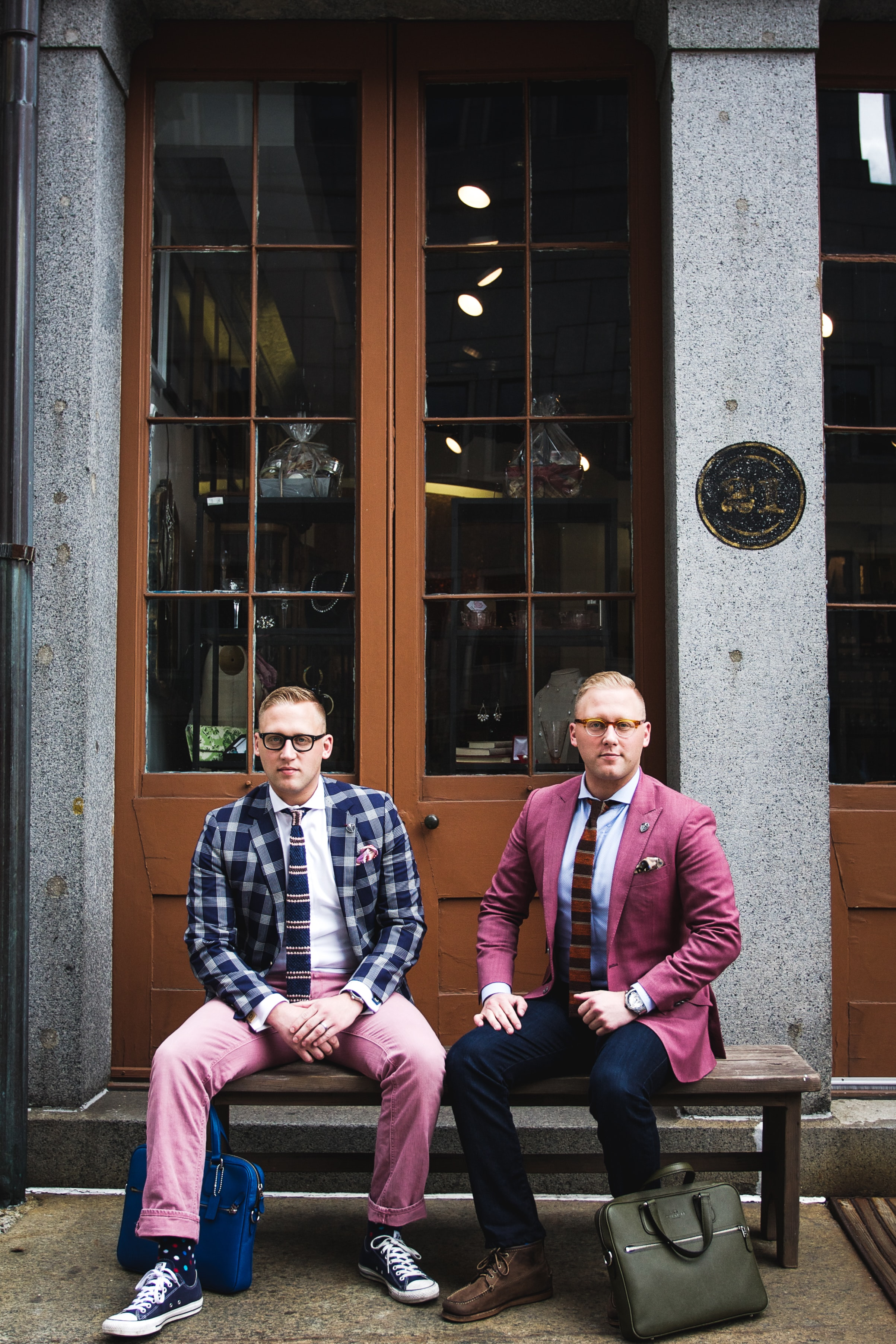 two man in formal suit sitting on bench chair