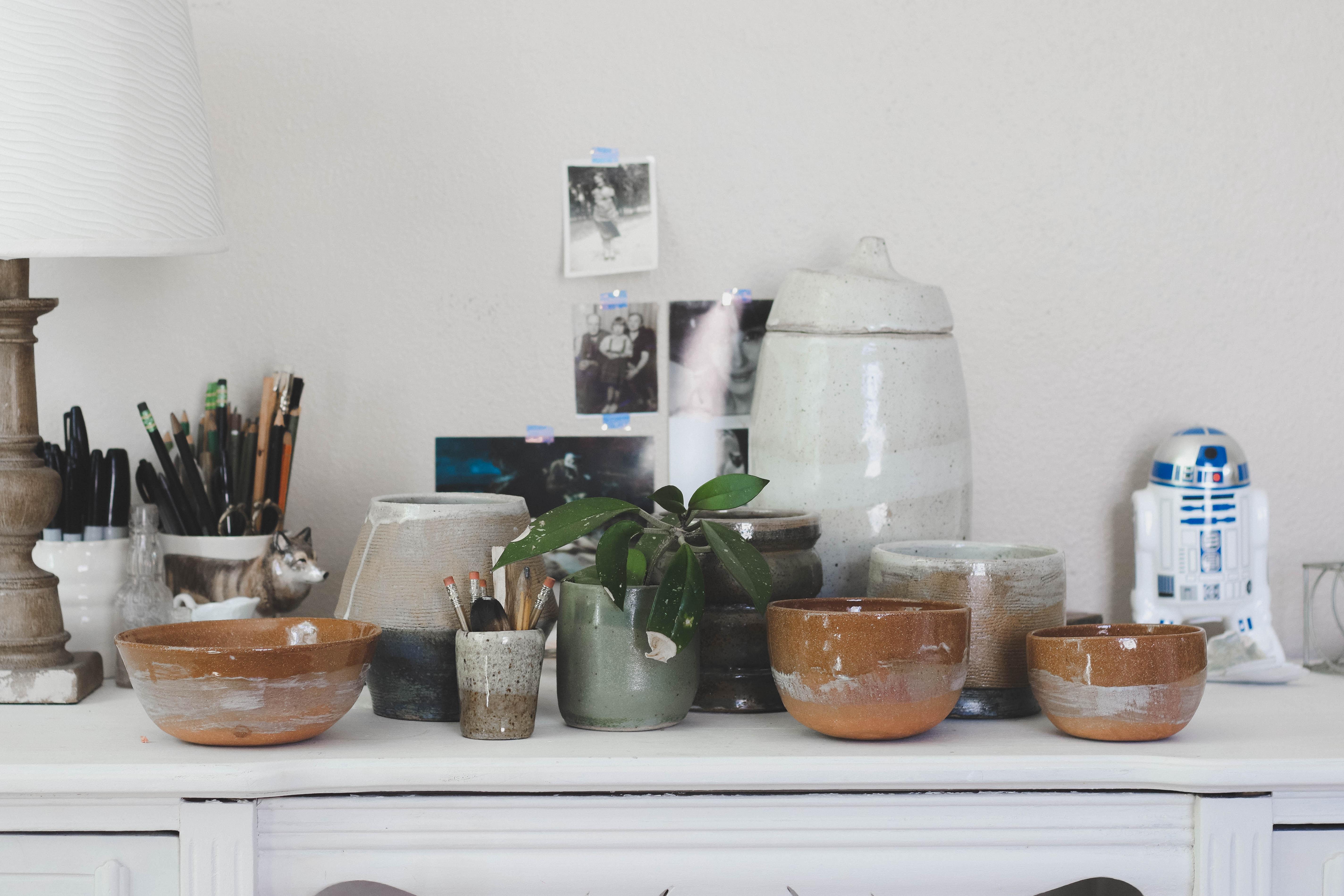 brown ceramic bowl on white wooden sideboard