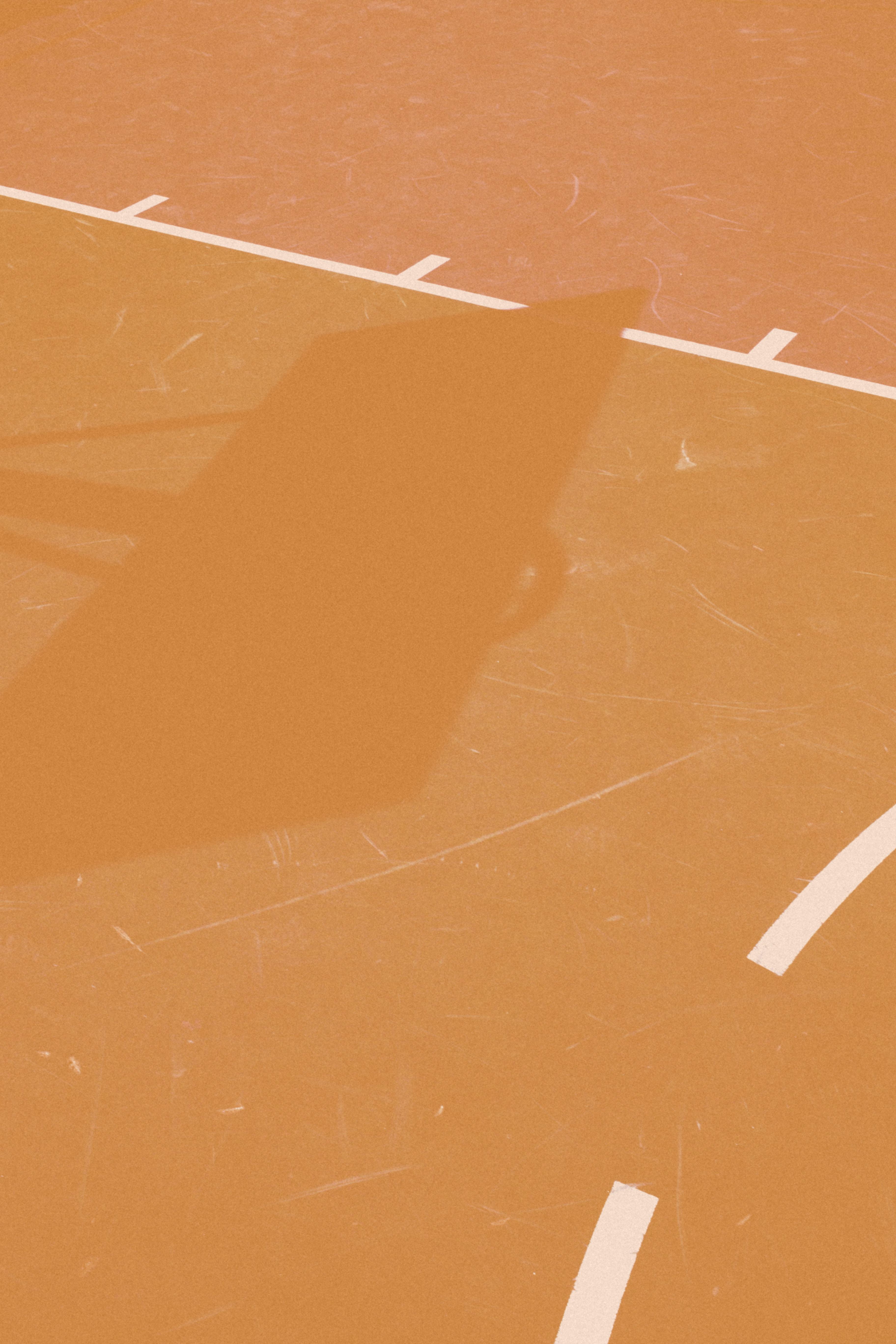 basketball hoop casting shadow on line