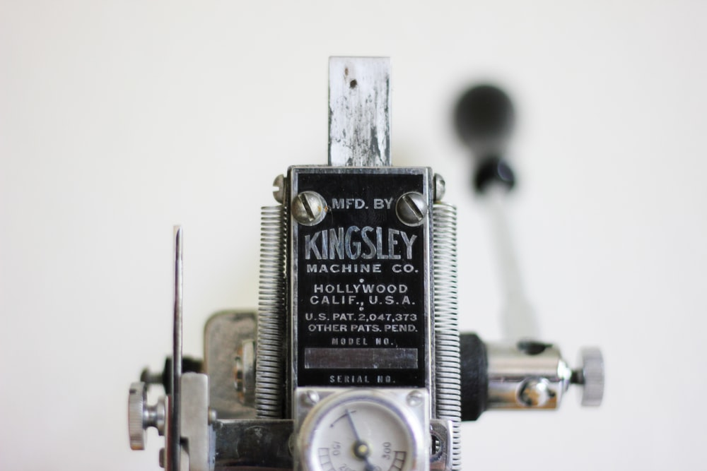 gray and black Kingsley hand lever machine