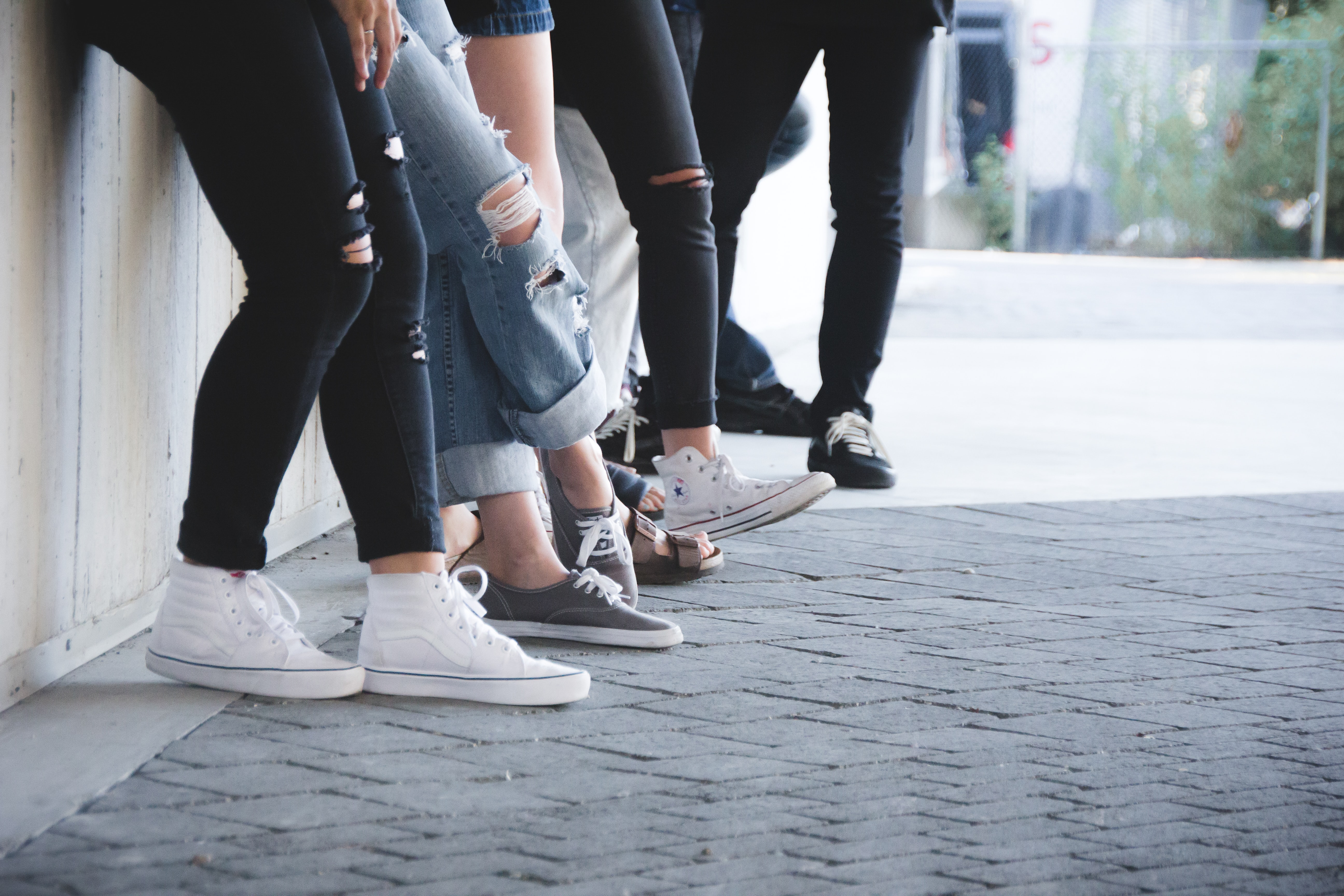people leaning on wall
