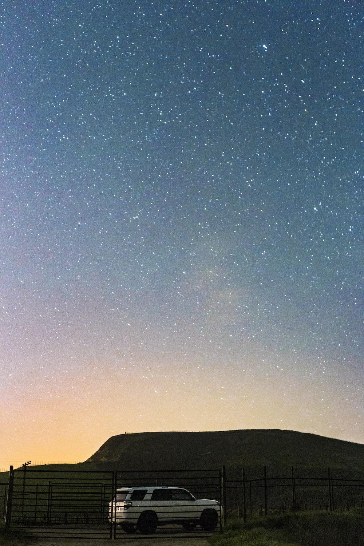 white SUV under star field