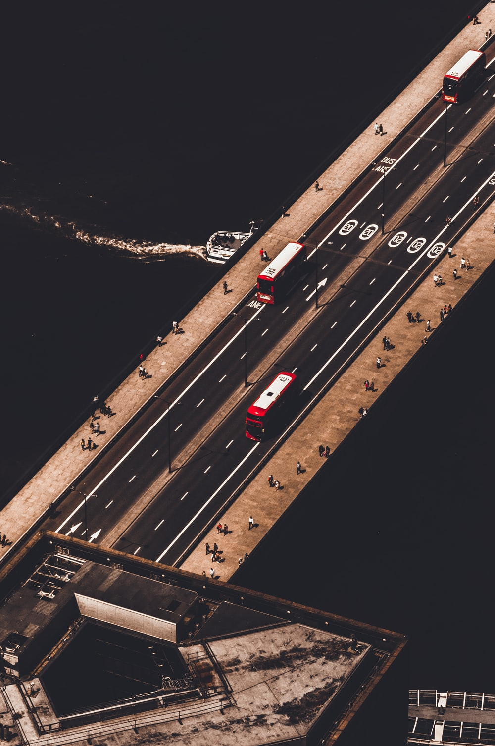 aerial photography of vehicle on road above body of water