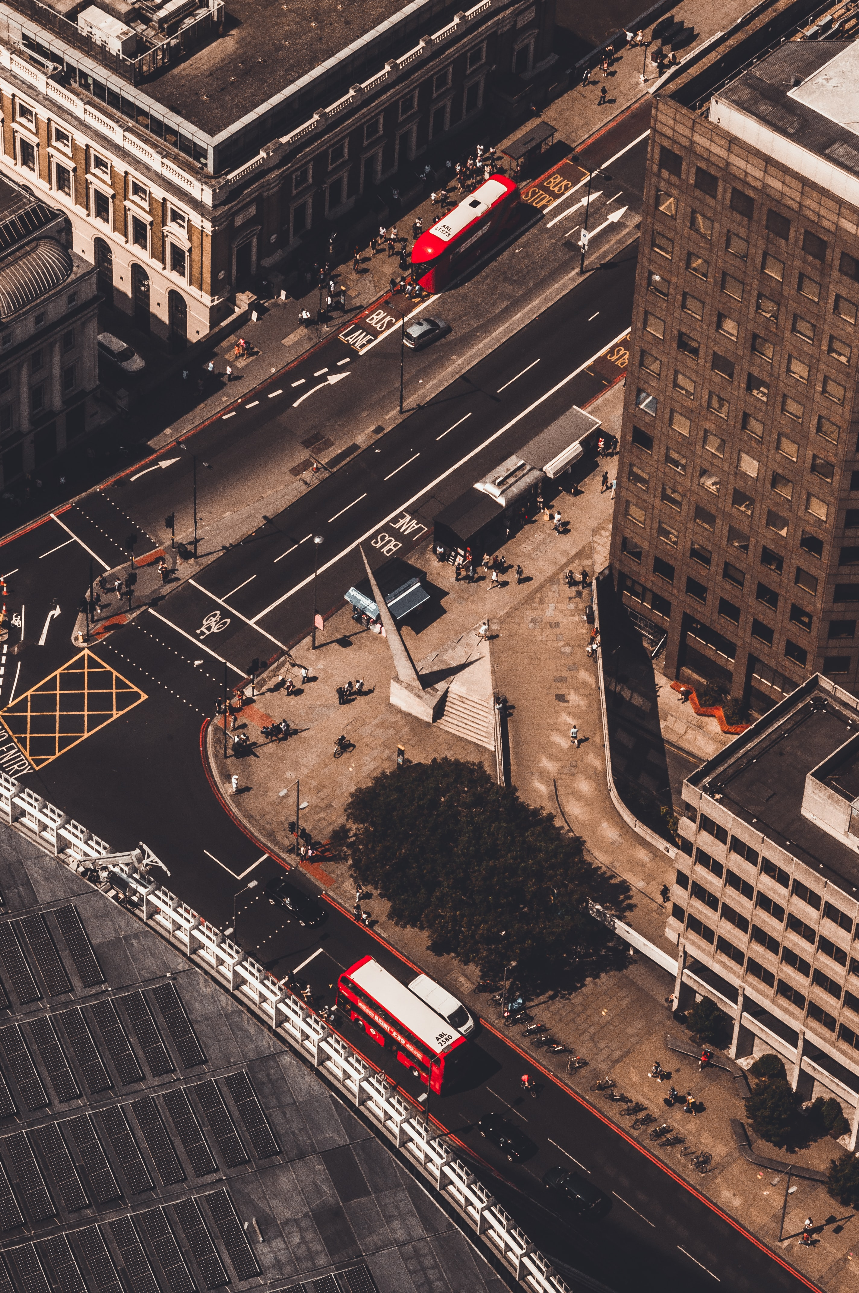 aerial photography of vehicles and people at the city
