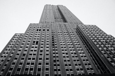 low-angle photography of high rise building art deco teams background