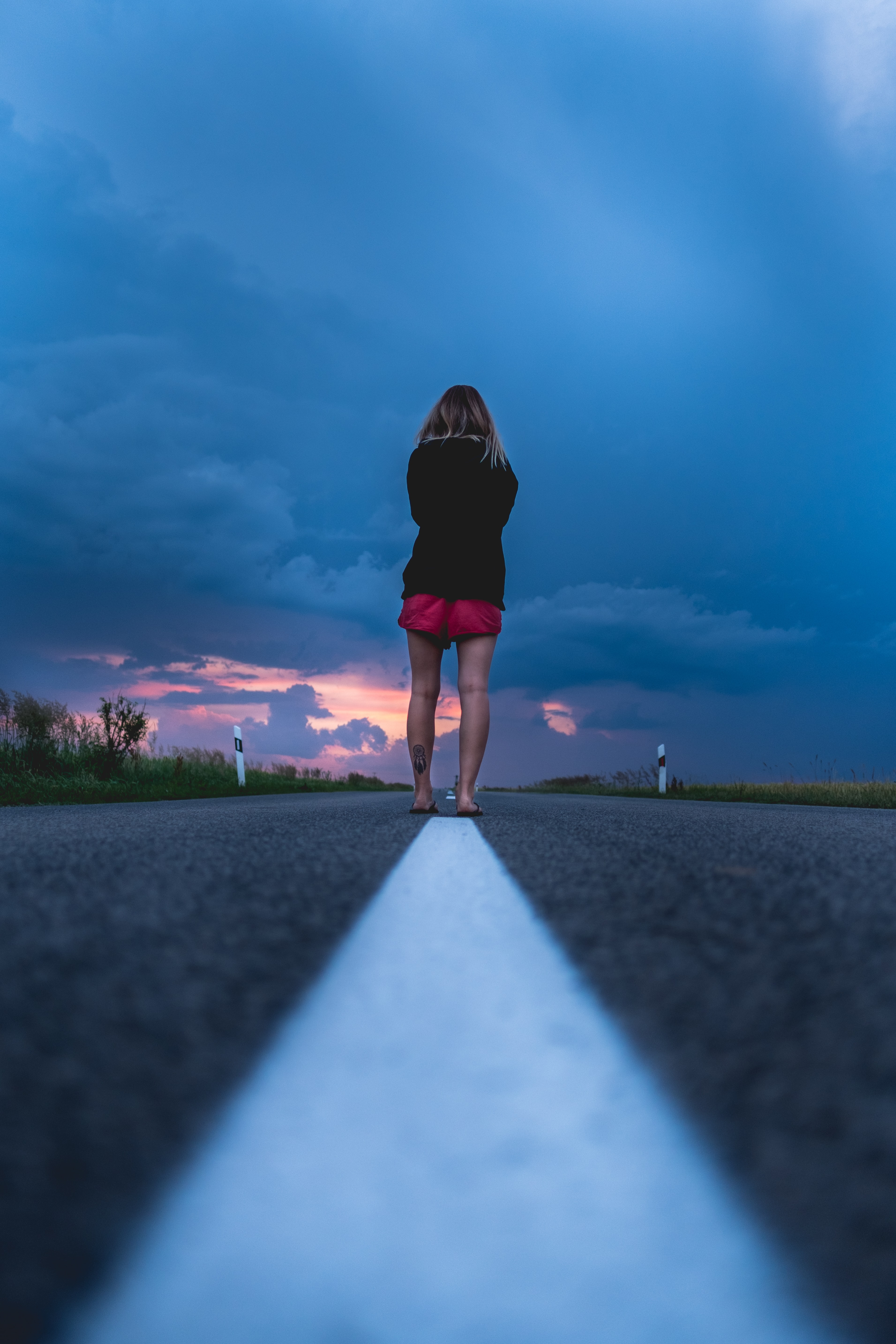 woman standing on the middle on road