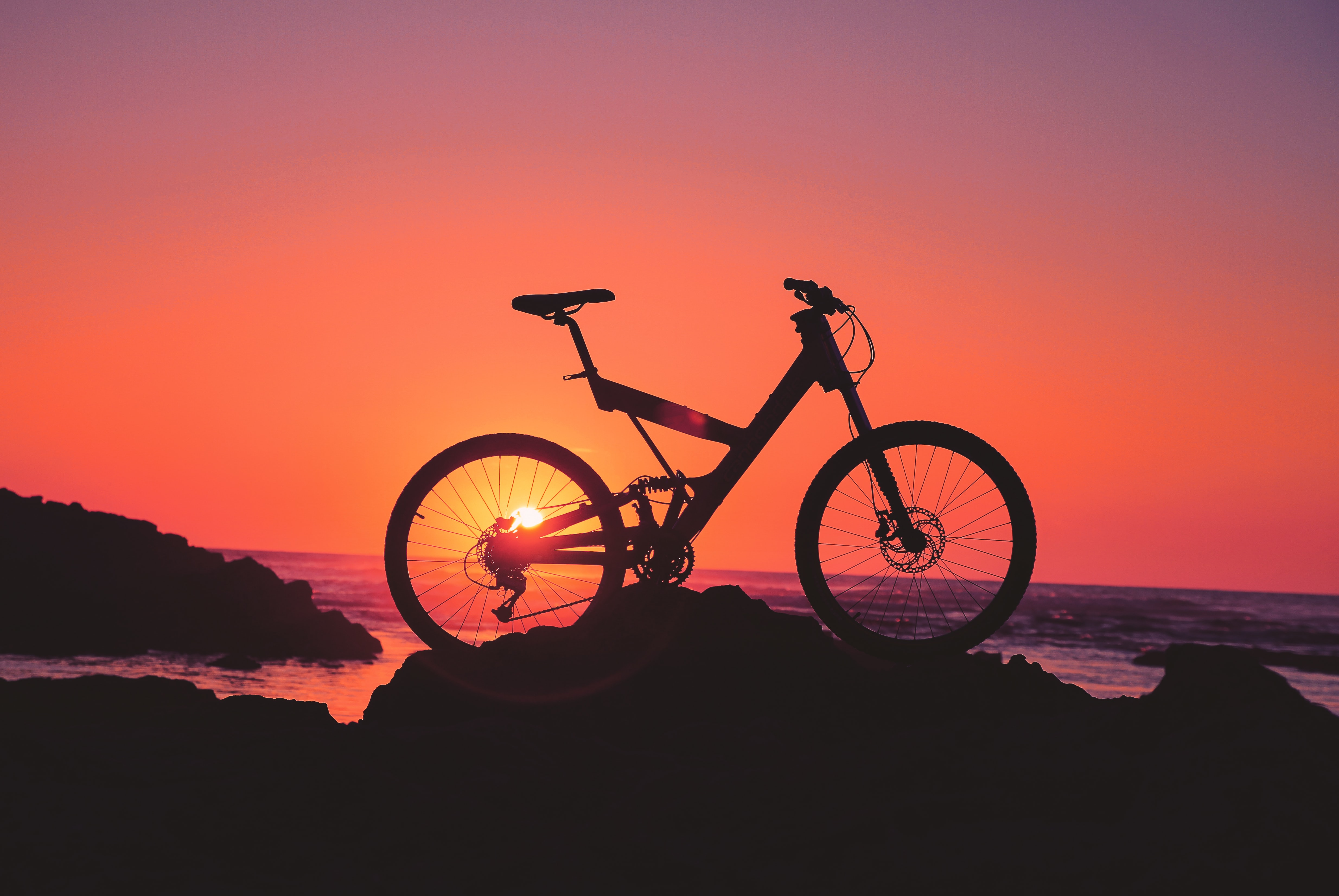 silhouette of a black bicycle during sunset
