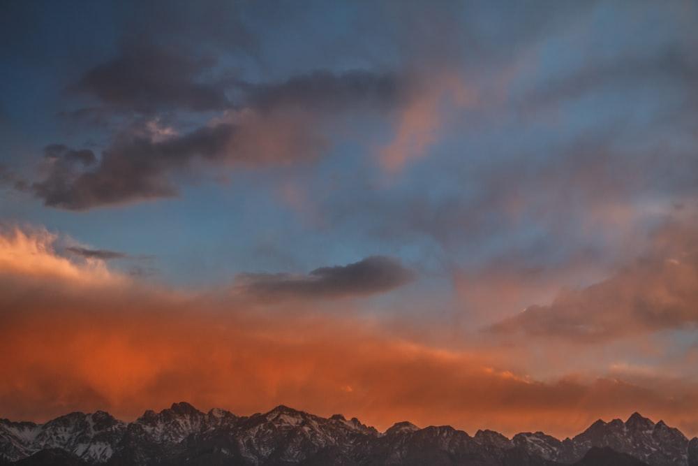 gray mountain range during sunset