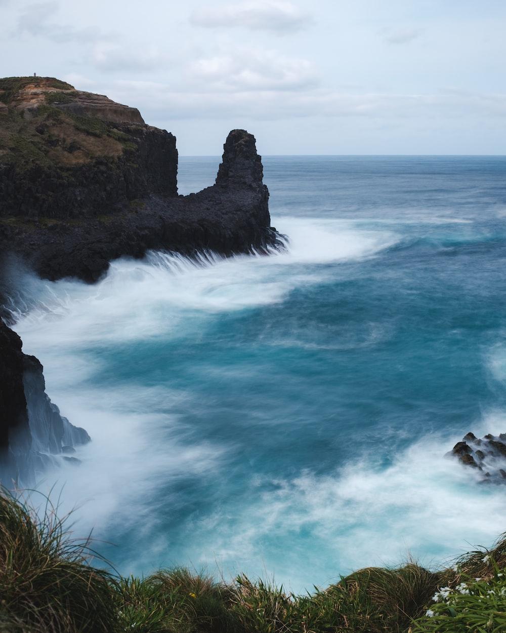 ocean water under gray sky