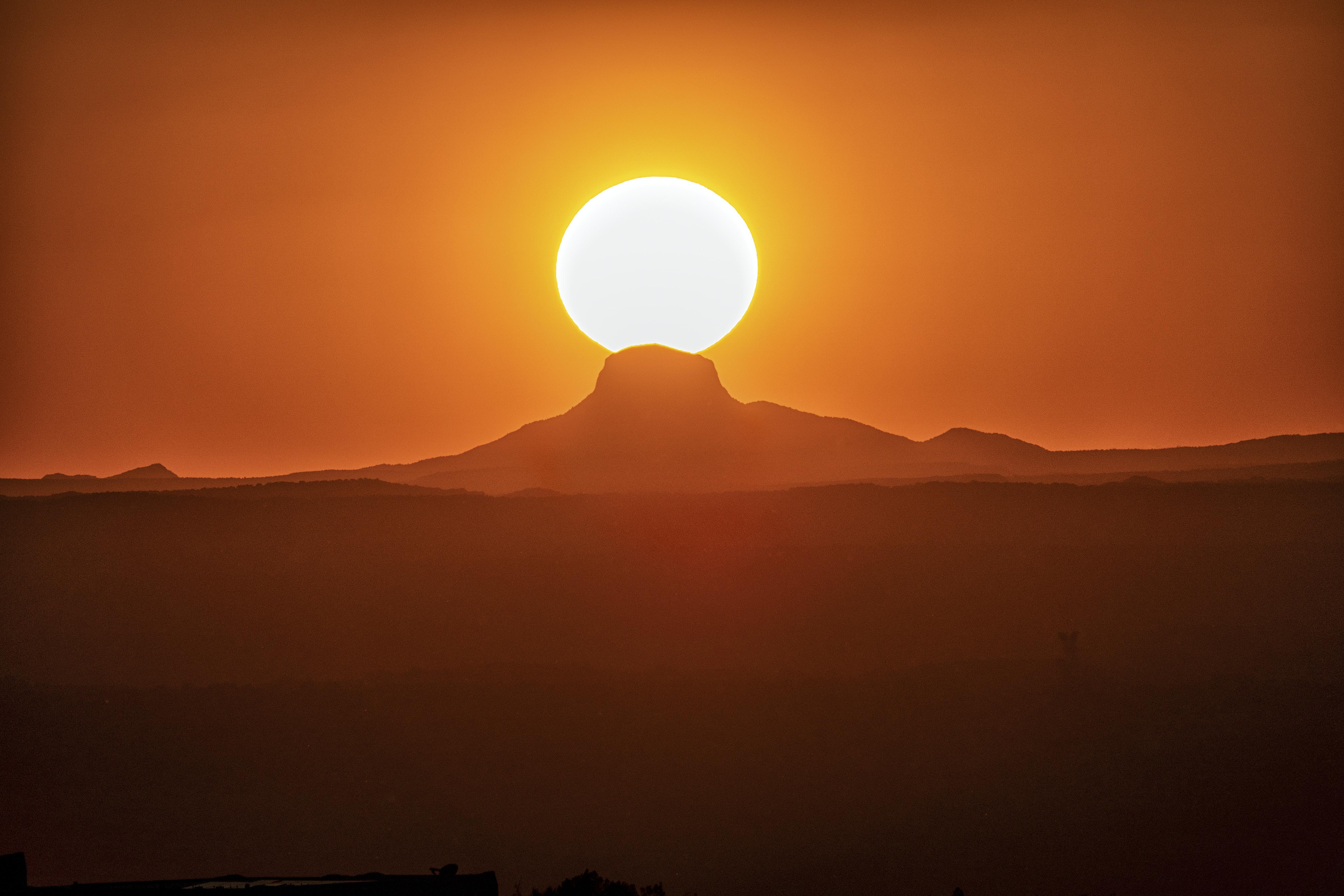 silhouette of mountain range during sunrise