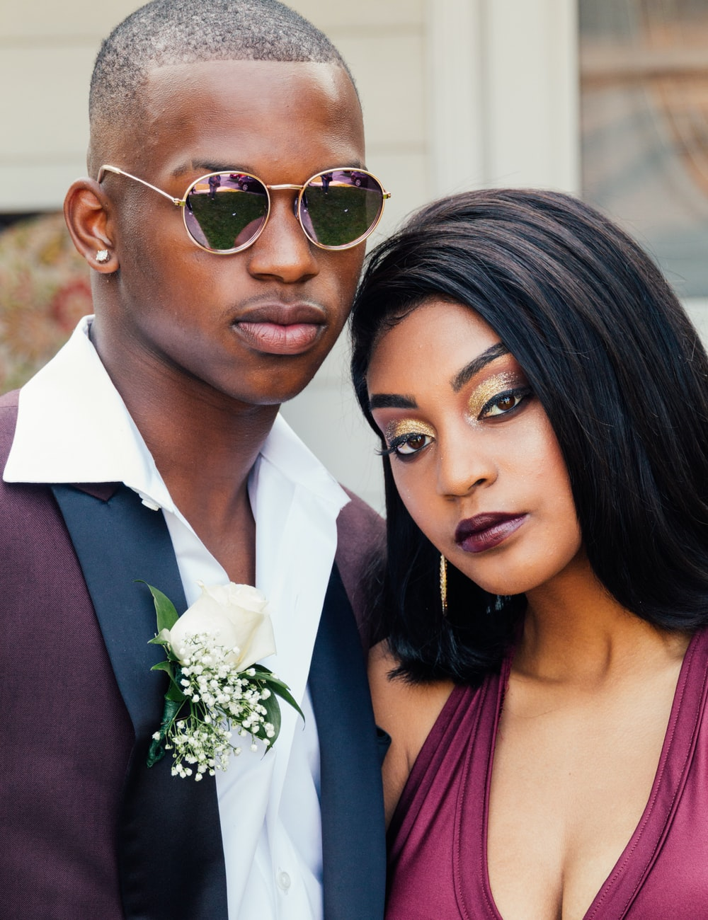 man and woman wearing formal suits
