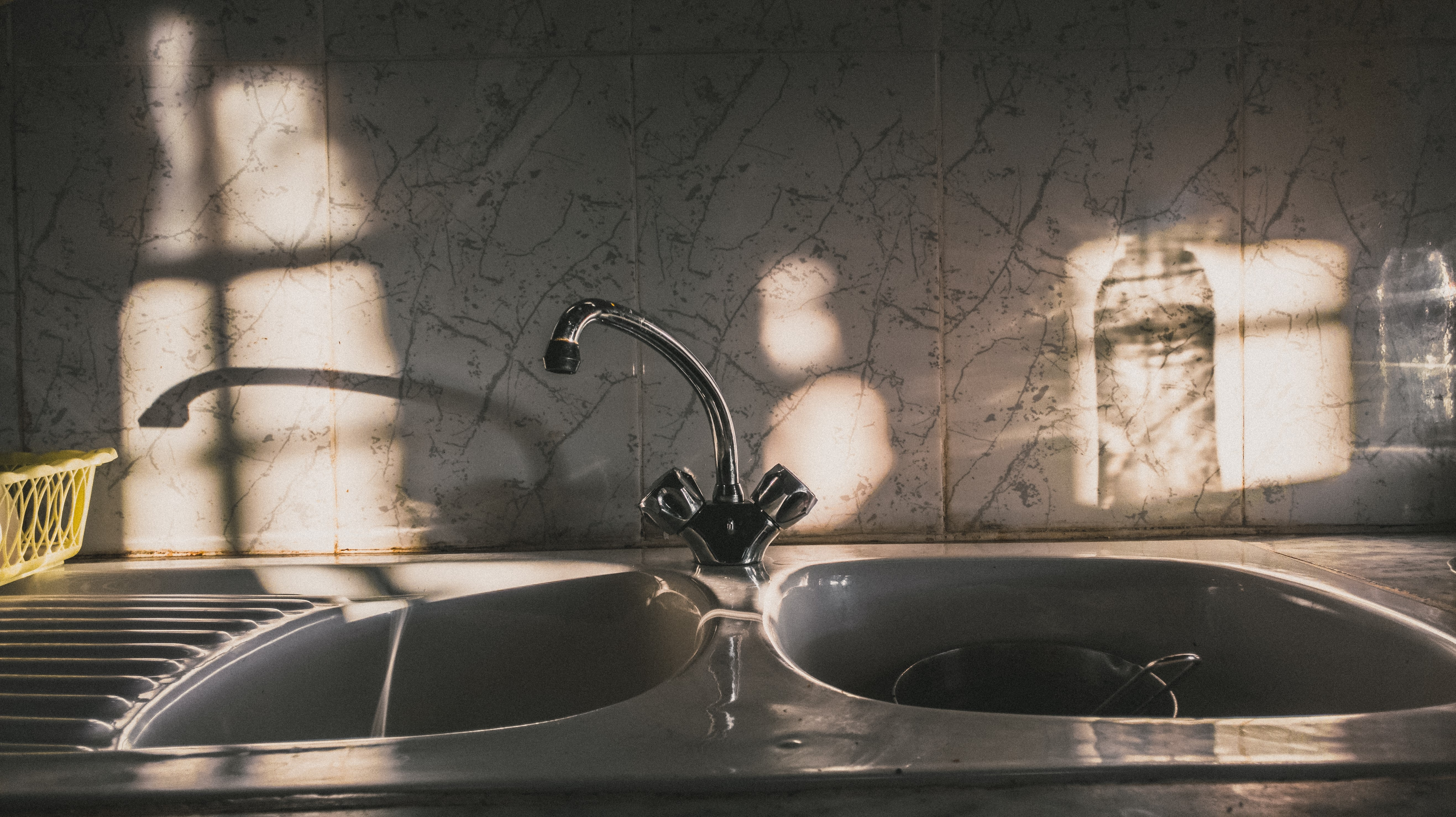 silver twin bowl sink with curve faucet
