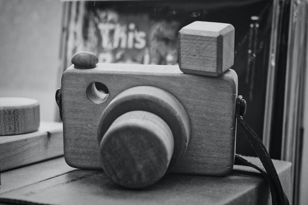 gray DSLR camera miniature