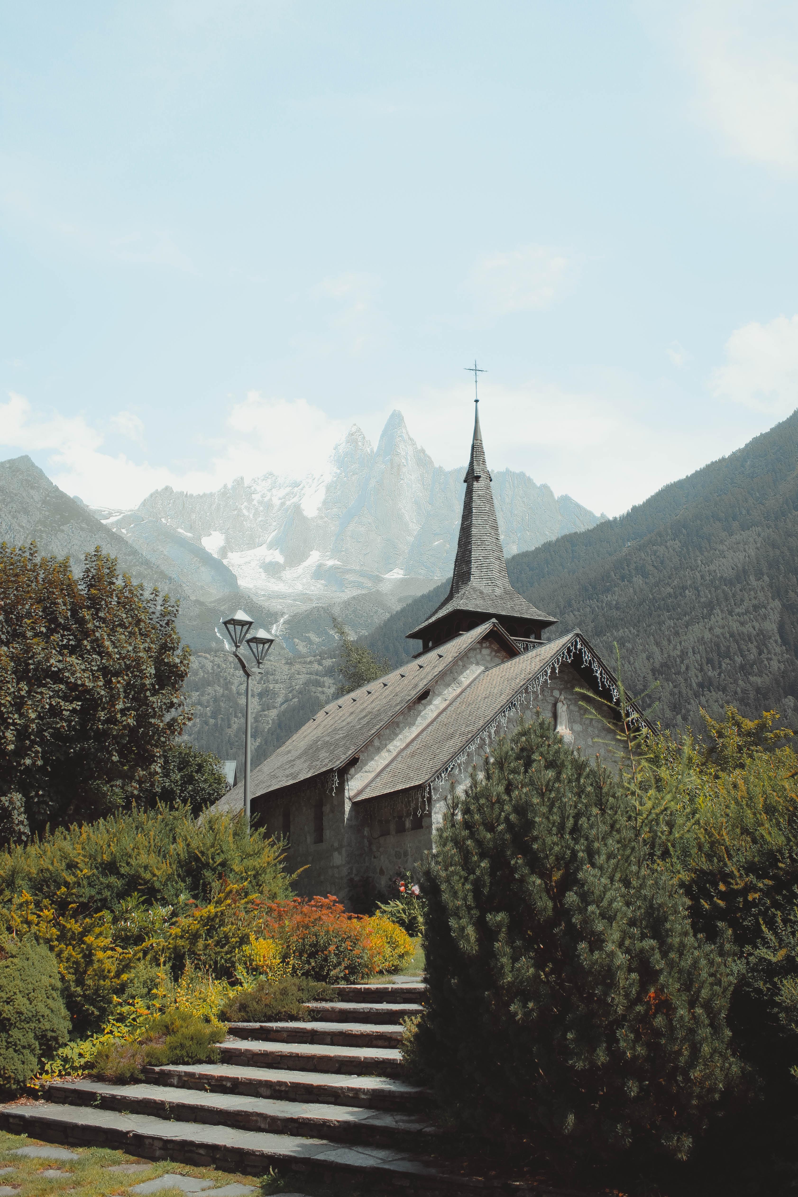 gray church beside mountain