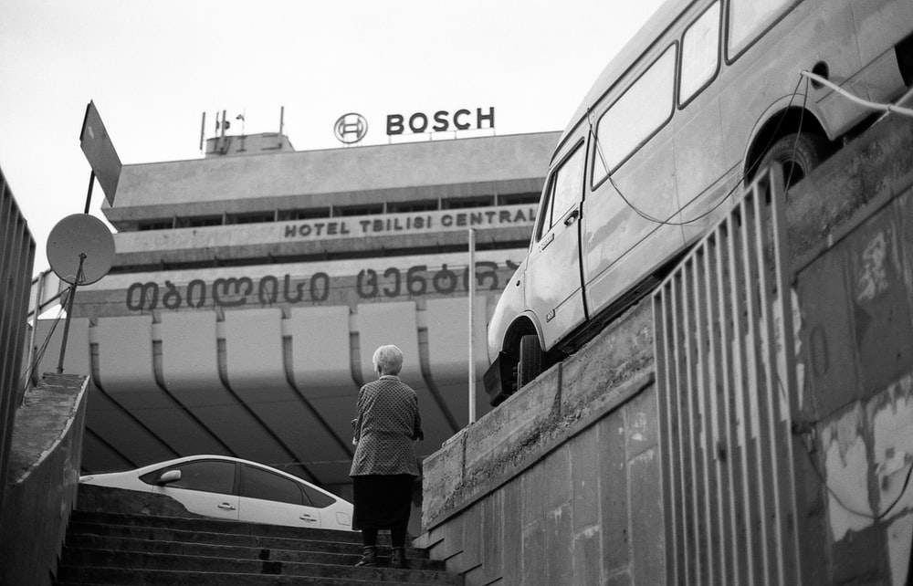woman standing on stairs near Bosch building