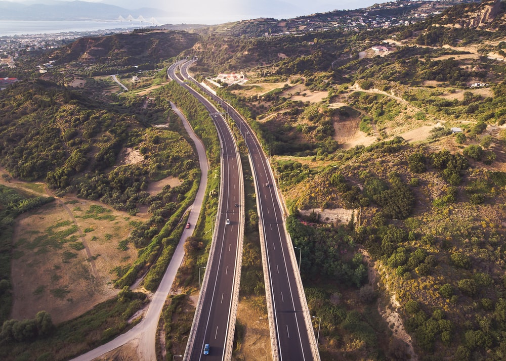 aerial photography of two lane road