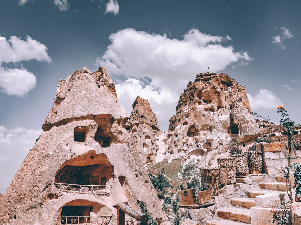 mountain with carved houses during daytime
