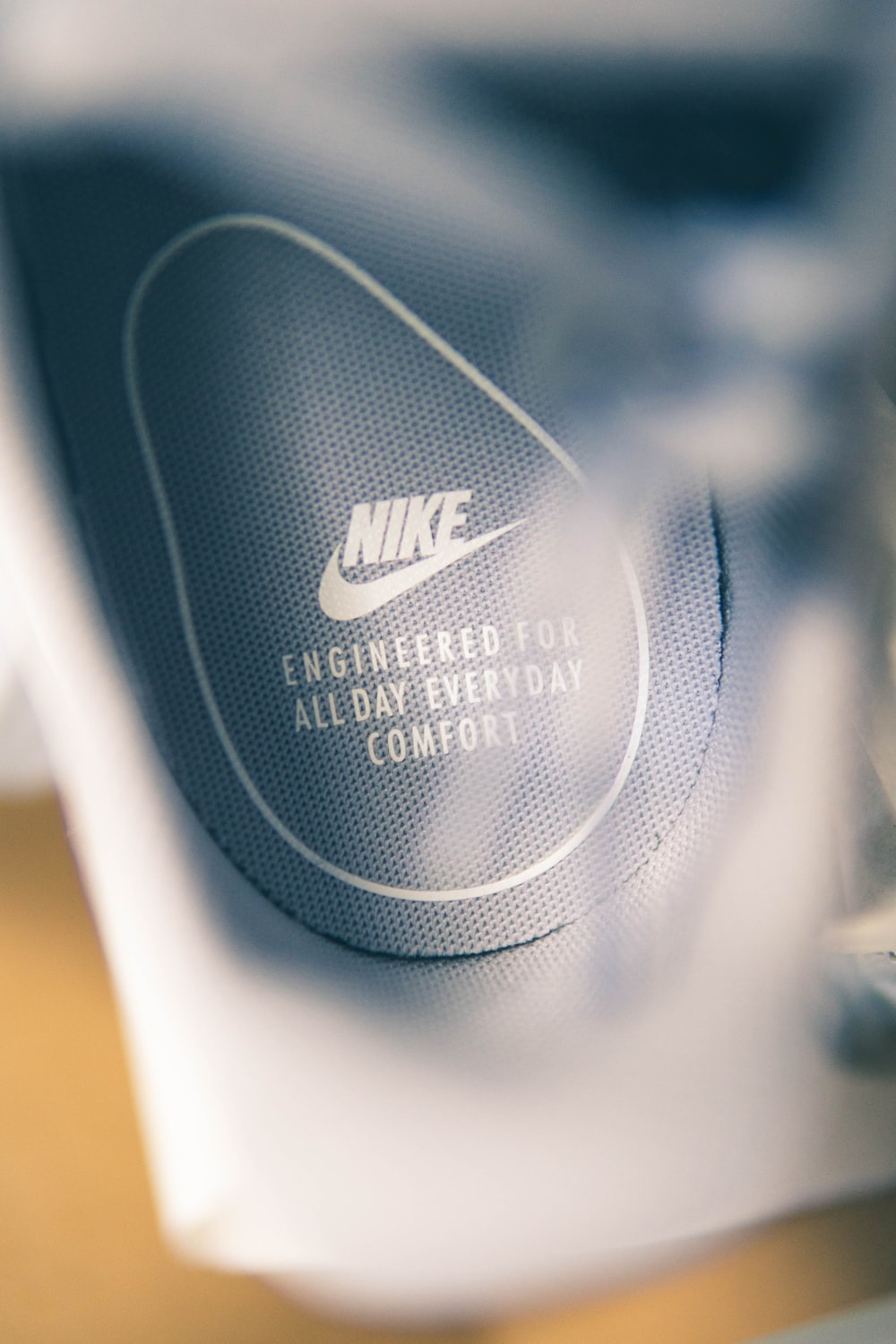 133d42b0914a68 selective focus photography of Nike logo