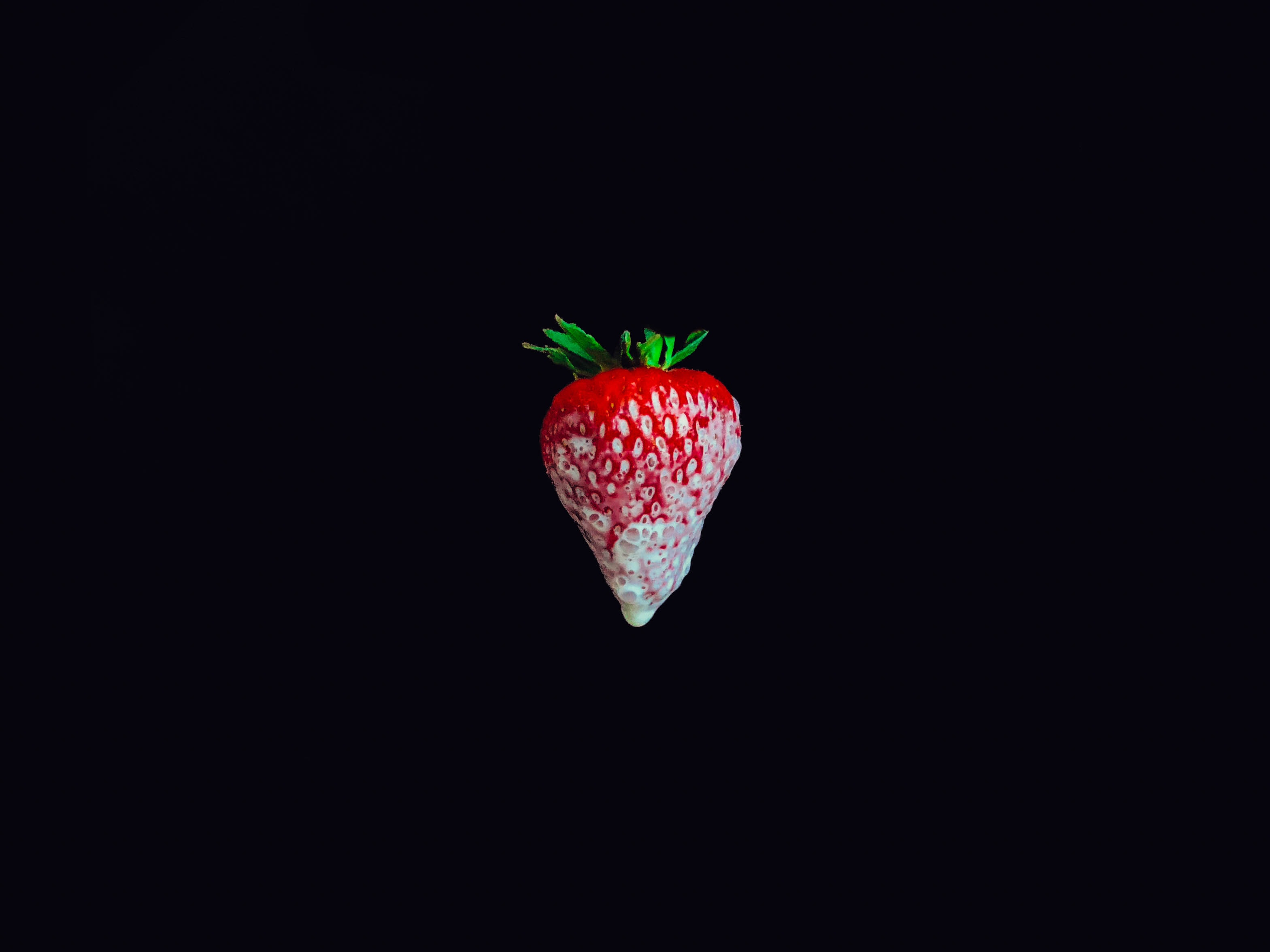 strawberry on black surface