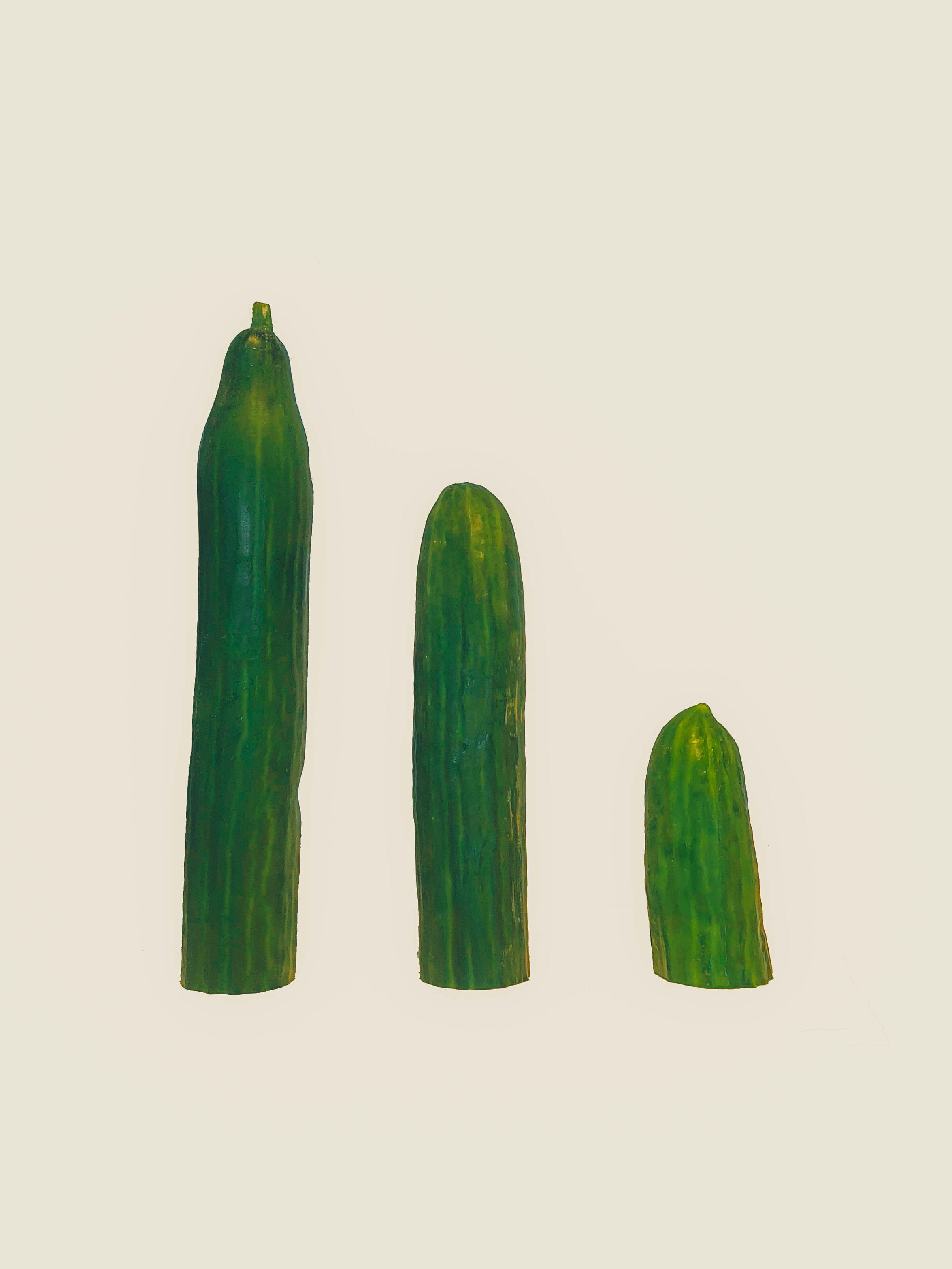 three cucumbers on white surface