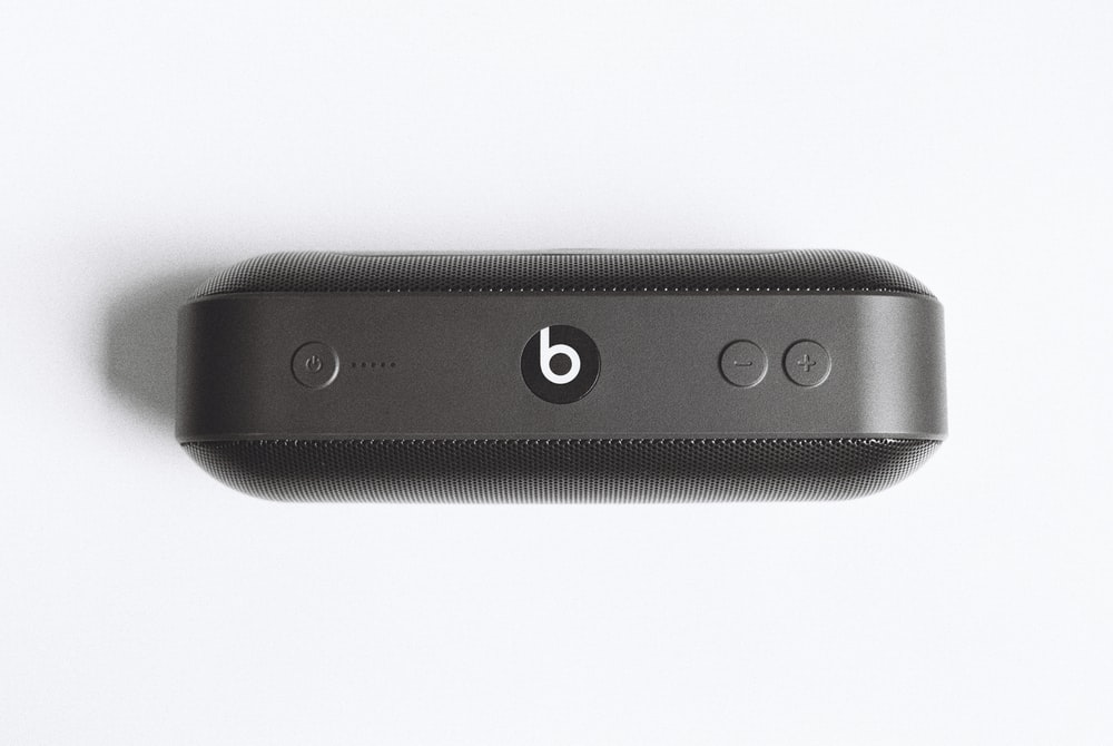 black Beats by Dr Dre beatspill + on white surface