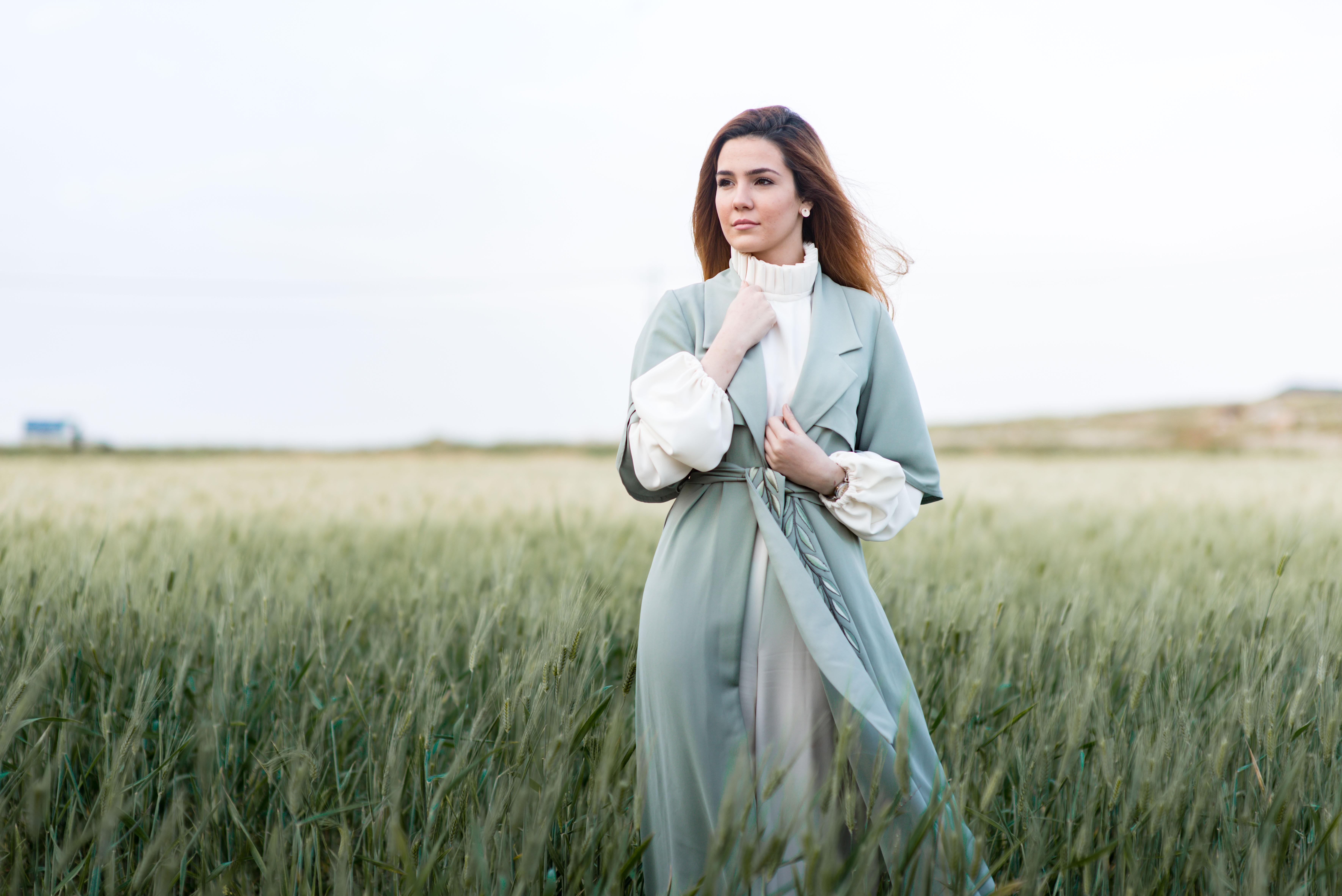 woman standing on grain fields