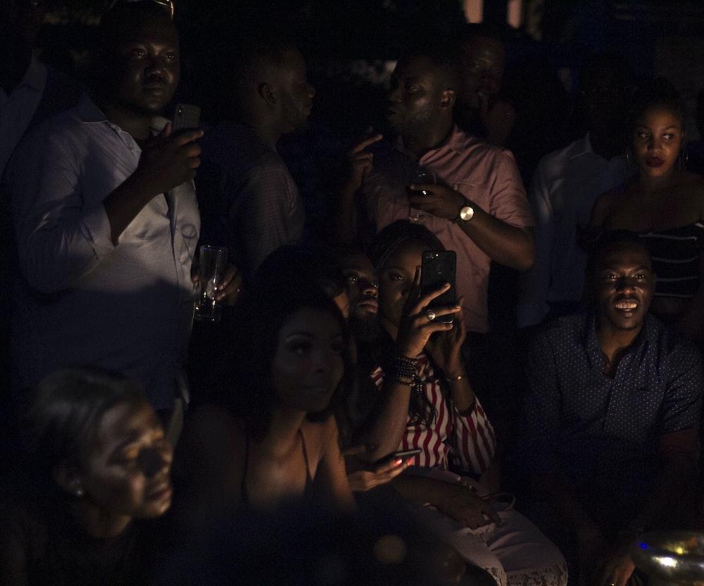 people taking photos on dark room
