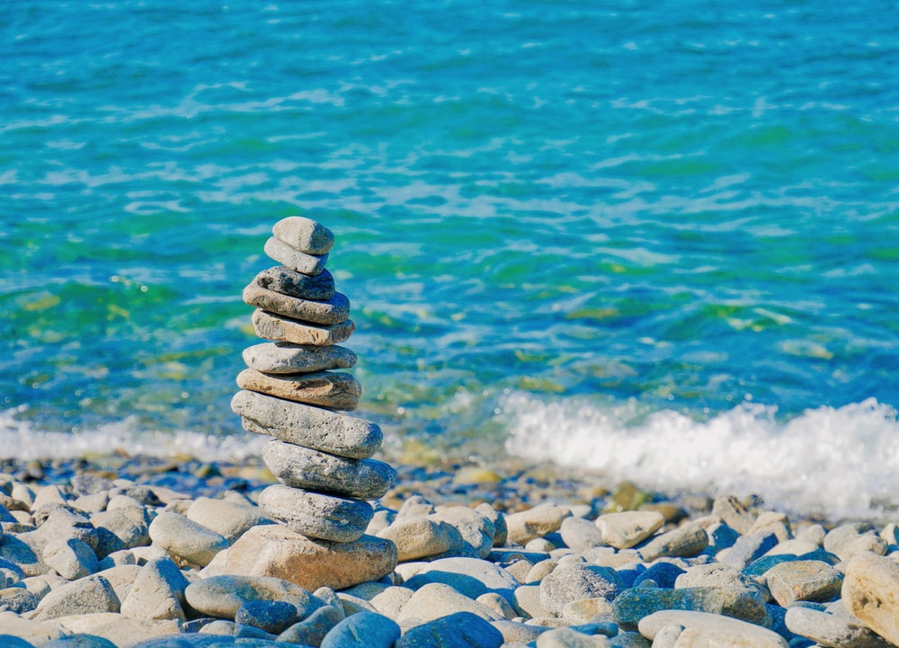 piled rock beside shoreline