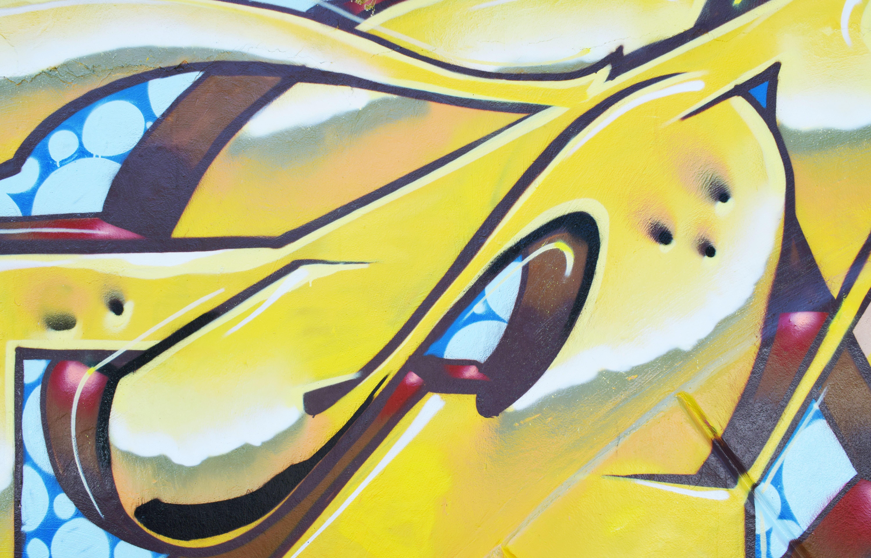 wall with yellow graffiti