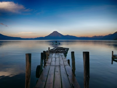 dock near water with cone mountain guatemala teams background