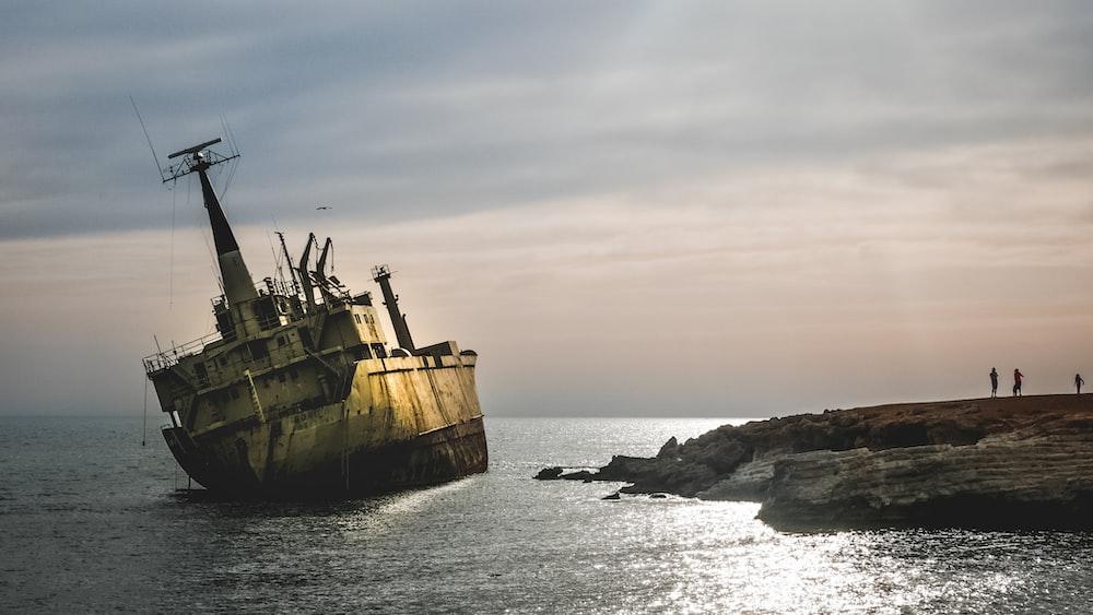 white ship docked near island