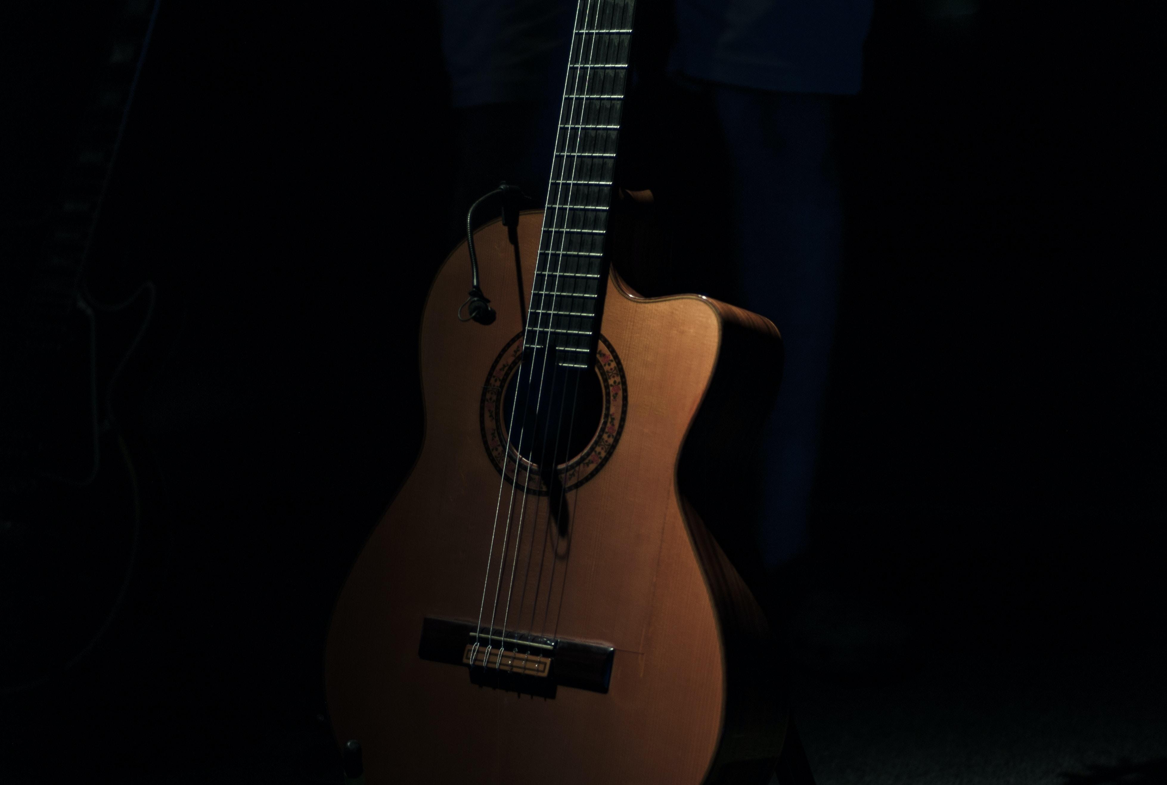 brown cutaway acoustic guitar