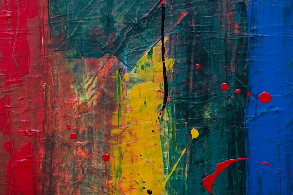 yellow, red, and green abstract paintng