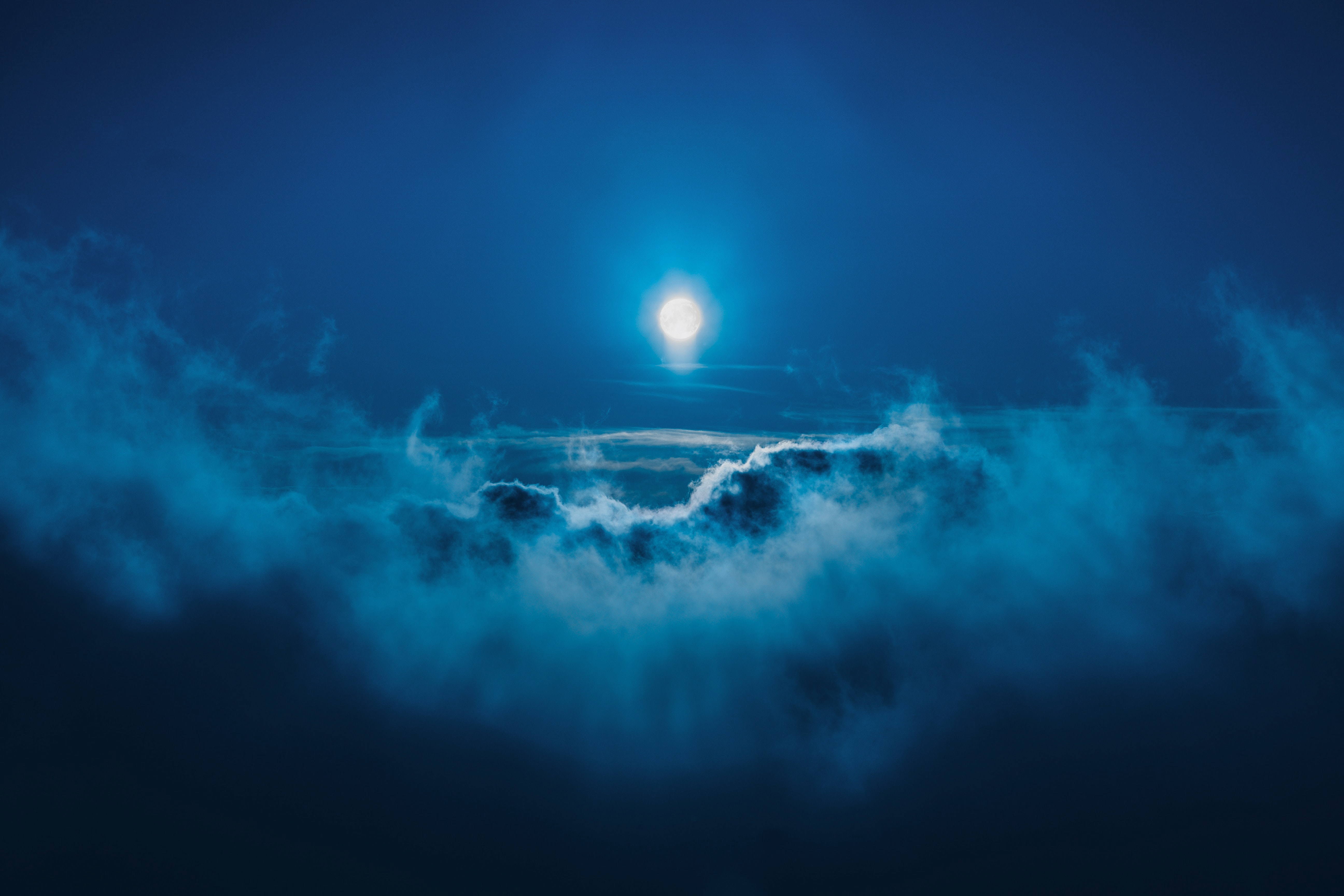 full moon along clouds
