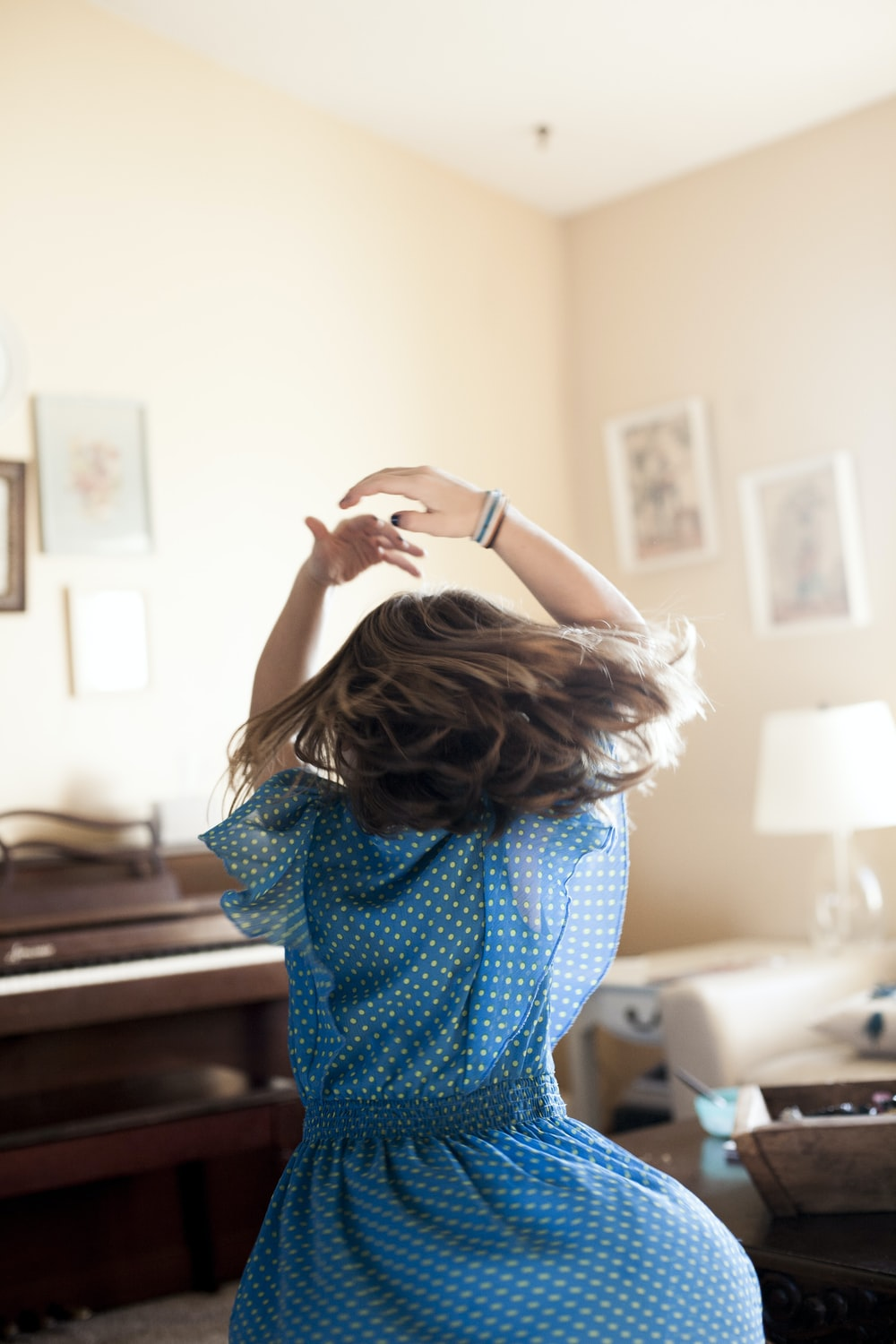 girl twirling around room