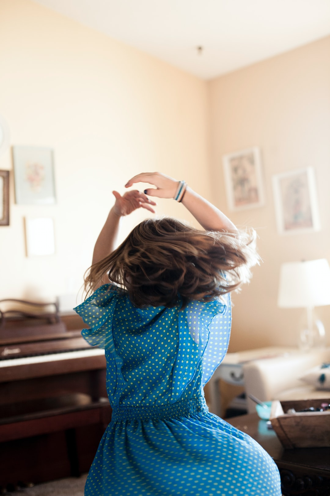 It was a normal Saturday morning at our house, and I pulled out my camera to document the happenings of our morning. My middle daughter put on some music and started dancing. The morning sun was shining through the windows beautifully as I caught her in mid twirl.