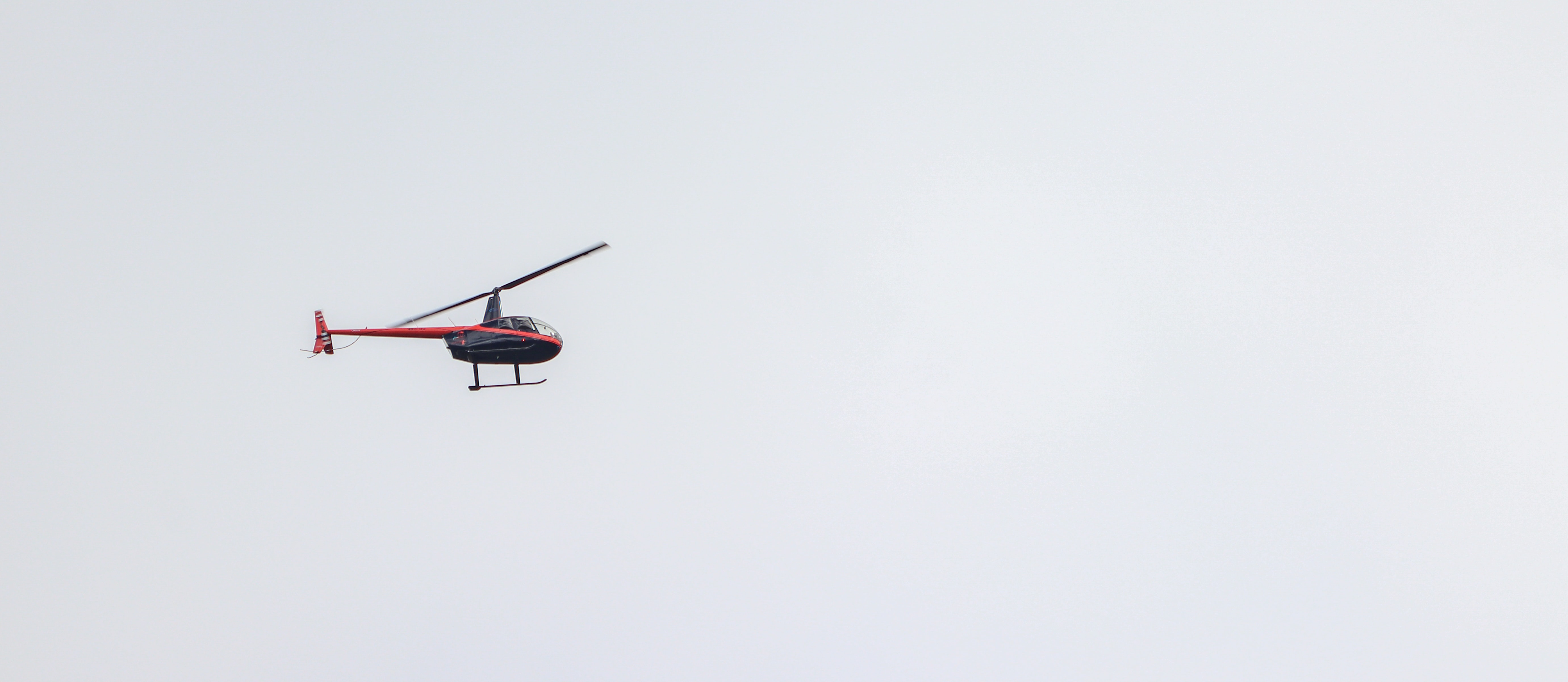 flying red helicopter