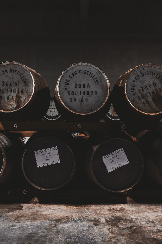 wooden barrels on rack
