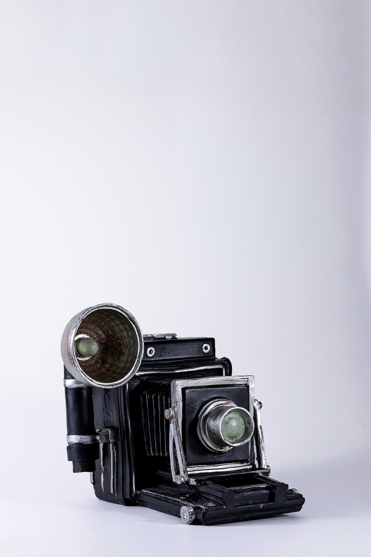 folding camera on white surface