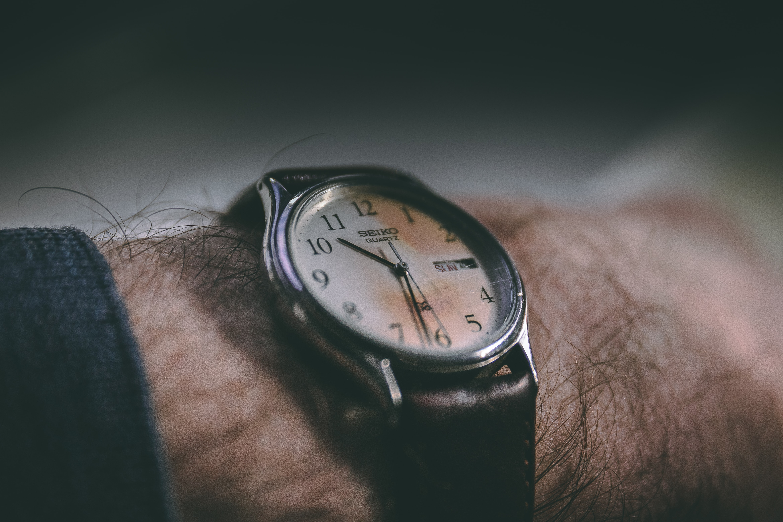 photo of round black analog watch