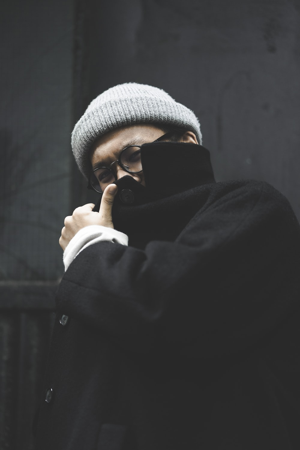 man covering his face with coat