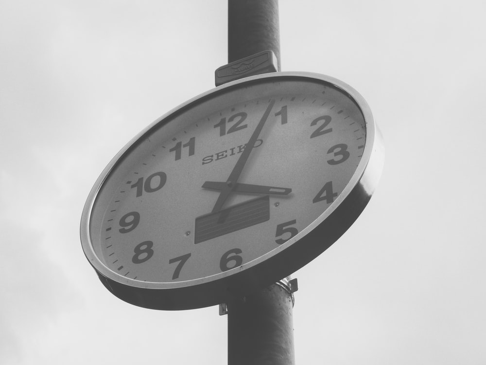 grayscale photo of wall clock displaying 4:04