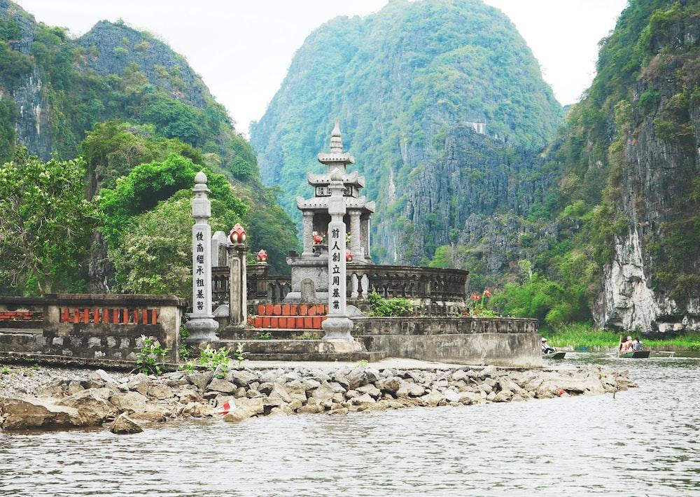 gray concrete altar near body of water