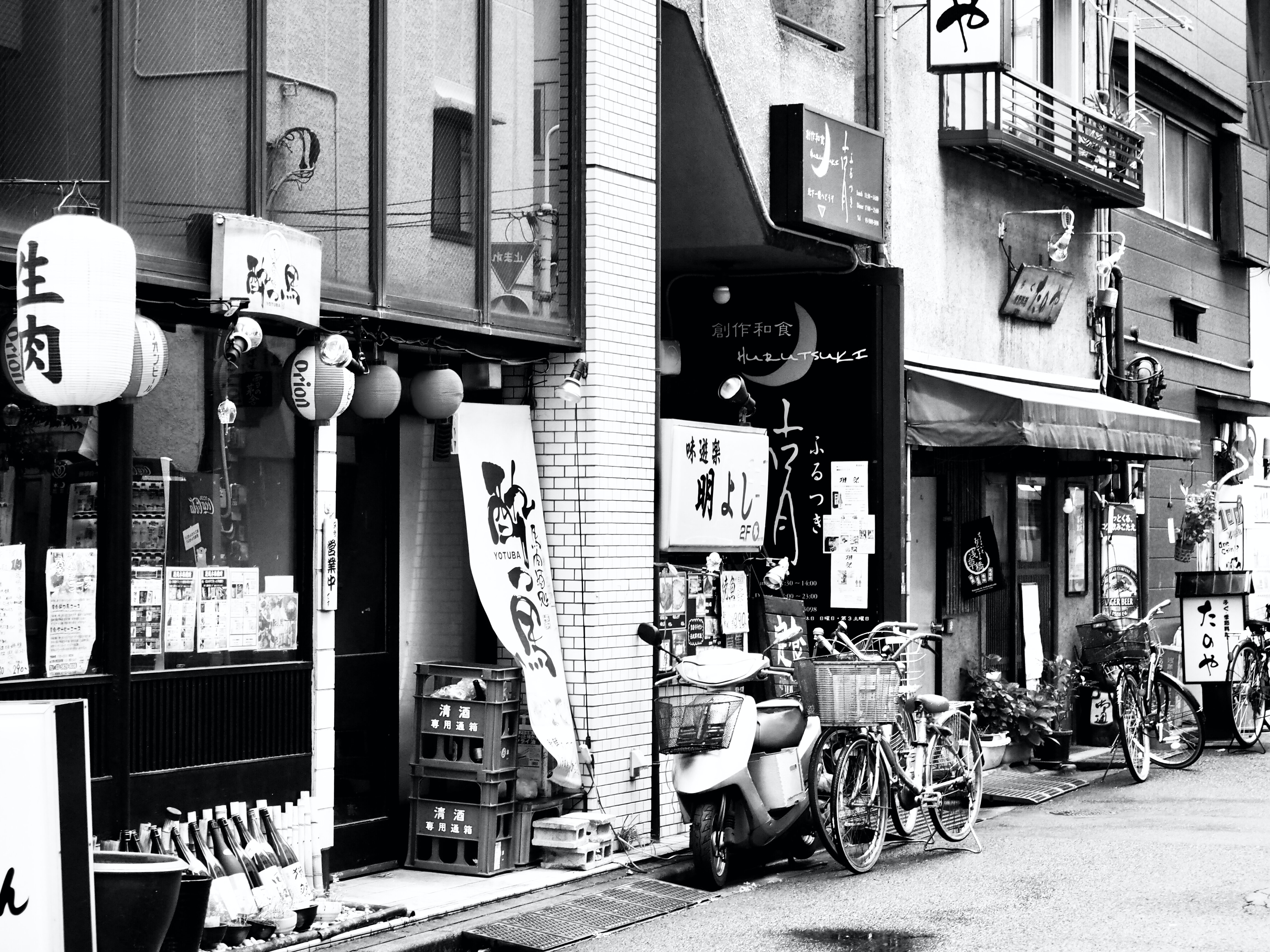 grayscaled photo of store front