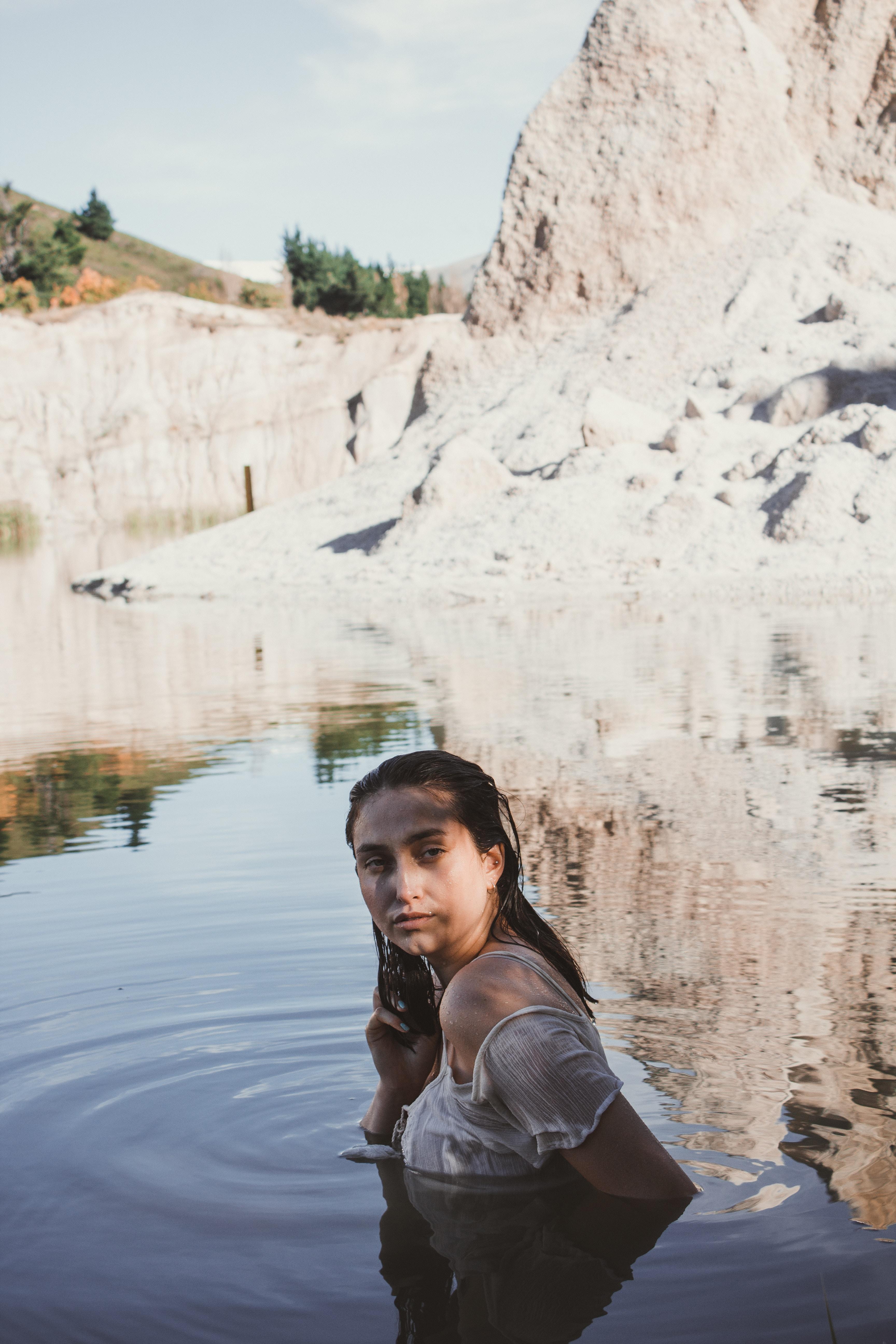 woman wearing white top soaking in water