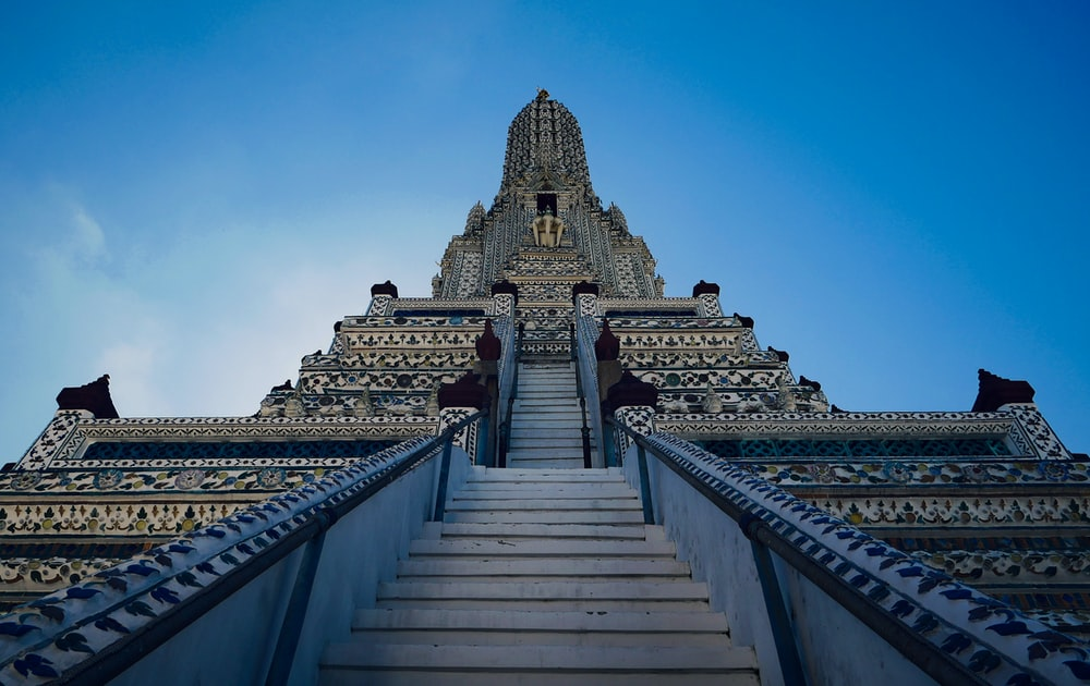 worm's-eye-view of gray concrete temple